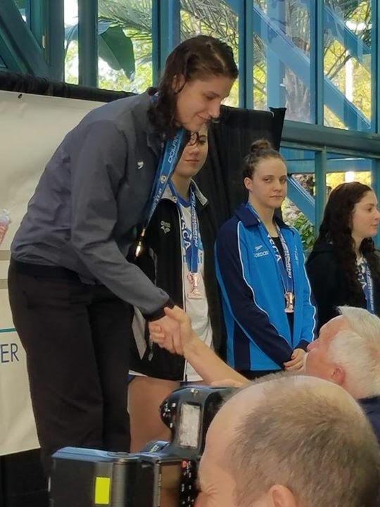Holly Jansen atop the podium