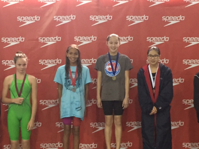 Eleanor Sun atop the podium in 200 Breast